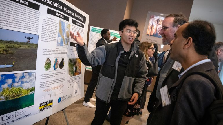 Student researcher presents poster at Symposium