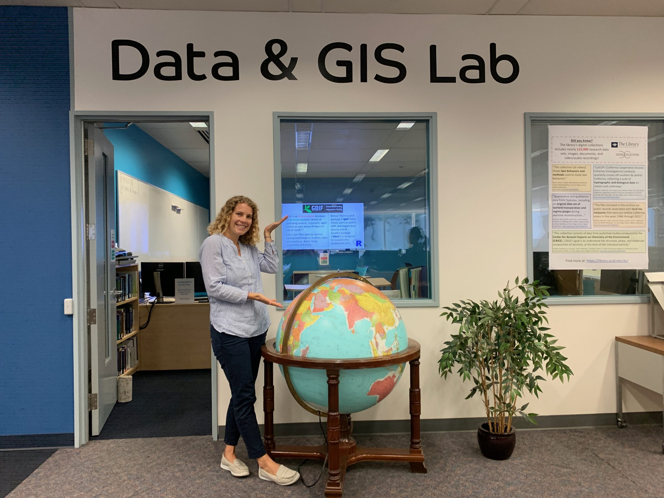 GIS Librarian Amy Work standing in front of the Data & GIS Lab, located on the main floor of Geisel Library